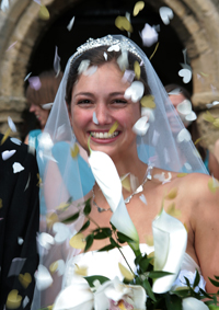 bride with confetti and flowers photographed by michael j dixon
