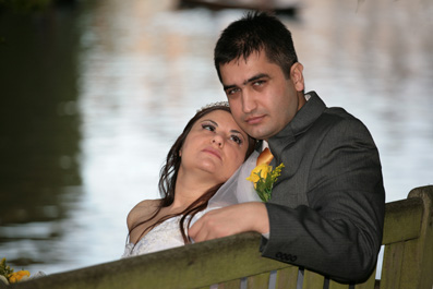 wedding couple by river cam